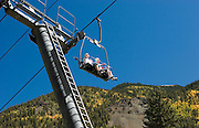 Close-up of couple on chairlift, Taos Ski Valley, New Mexico<br />