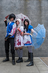 © Licensed to London News Pictures. 24/05/2015. London, UK. A group dressed as (L to R) Alister, Hysteria and Alice from Alice Madness Returns pose, as fans of anime, comic books, video games and more gather in large numbers at the Excel Centre to attend the bi-annual MCM Comic Con. Photo credit : Stephen Chung/LNP