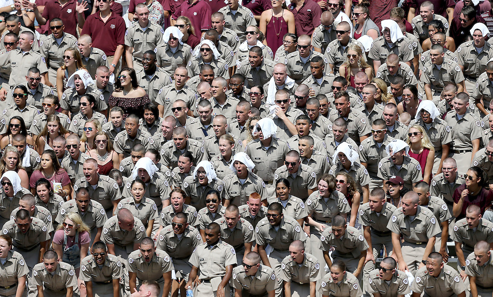 Members of the Texas A&M Corps of Cadets chant yells during the second quarter of an NCAA college football game against UCLA Saturday, Sept. 3, 2016, in College Station, Texas. (AP Photo/Sam Craft)
