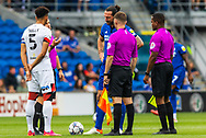 Today's referee Joshua Smith tosses a coin with Bournemouth Captain and defender Lloyd Kelly (5) and Cardiff City defender and Captain Sean Morrison (4)  during the EFL Sky Bet Championship match between Cardiff City and Bournemouth at the Cardiff City Stadium, Cardiff, Wales on 18 September 2021.