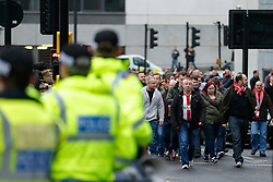 Sunderland supporters make their way to the ground with a heavy Police presence holding back the Newcastle United fans - Photo mandatory by-line: Rogan Thomson/JMP - 07966 386802 - 21/12/2014 - SPORT - FOOTBALL - Newcastle upon Tyne, England - St James' Park - Newcastle United v Sunderland - Tyne-Wear derby - Barclays Premier League.
