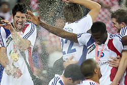 Nikola Karabatic (13) of France celebrates after the 21st Men's World Handball Championship 2009 Gold medal match between National teams of France and Croatia, on February 1, 2009, in Arena Zagreb, Zagreb, Croatia. France won 24:19 and became World Champion 2009.  (Photo by Vid Ponikvar / Sportida)