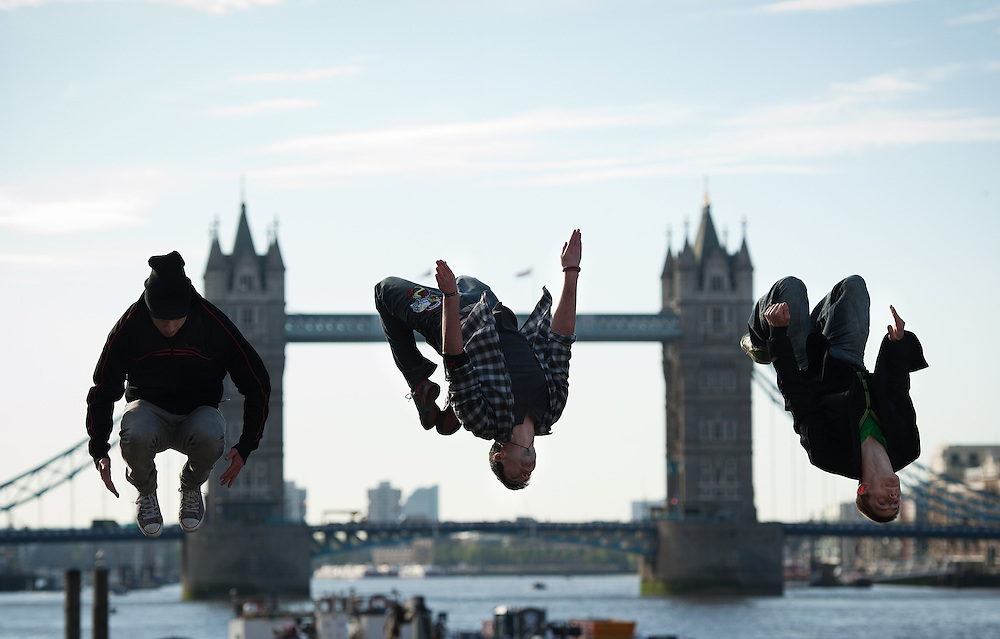 """Parkour free running group """"3RUN"""" preform jumps in front of Tower `Bridge in London UK on May 14th 2012..Transport for London (TfL) and Network Rail are encouraging those travelling during Olympic  Games-time to make short journeys on foot as Living Streets Walk to Work Week launches. World renowned free-running group 3RUN will perform parkour stunts between London Bridge and Monument stations to help raise awareness of the Get Ahead of the Games initiative..Photo/ Ki Price .........."""