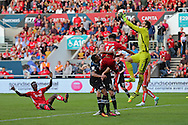 Derby goal keeper Scott Carson (1) jumps high to save the ball, the is score 1-1  during the EFL Sky Bet Championship match between Bristol City and Derby County at Ashton Gate, Bristol, England on 17 September 2016. Photo by Gary Learmonth.