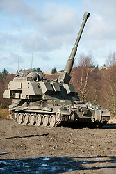 A Royal Artillery AS90 155mm Self Propelled gun on exercise Steel Sabre. A large Scale military live fire exercise on Otterburn Training Area it involves 1400 troops the majority from the Royal Artillery 1st Artillery Brigade and brings all the components of an effective Artillery group together to train in delivering firepower on the battlefield.<br /> <br />   02 March 2017 <br />   Copyright Paul David Drabble<br />   www.pauldaviddrabble.co.uk