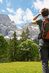 Mountain scenery, Man hiking with backpack, rear view