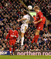 Photo. Jed Wee.<br /> Liverpool v Bolton Wanderers, FA Barclaycard Premiership, Anfield, Liverpool. 26/12/2003.<br /> Liverpool's Sami Hyypia (R) rises above Bolton's Kevin Davies to head in the opening goal as Florent Sinama-Pongolle looks on.