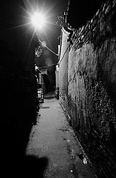 Night view of a narrow hutong, or alleyway, in central Beijing