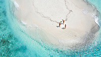 Aerial view of a sandbank, North Malé Atoll, Maldives, Indian Ocean with  people sunbathing