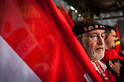01/05/2015 – Berlin, Germany: A member of DGB, the Confederation of German Trade Unions, holds a flag of the organization during the speech in front of the Brandenburg gate to celebrate the International Workers Day. The International Workers Day is a celebration of laborers and the working classes that is promoted by the international labor movement, anarchists, socialists, and communists and occurs every year on May Day. (Eduardo Leal)
