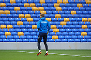 AFC Wimbledon goalkeeper Connal Trueman (1) warming up prior to kick off wearing jacket that is sponsored by Football Manager during the EFL Sky Bet League 1 match between AFC Wimbledon and Lincoln City at Plough Lane, London, United Kingdom on 2 January 2021.