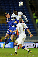 Leed's captain Sol Bamba (highest) beats Cardiff's Anthony Pilkington to a header (blue).  Skybet football league championship match, Cardiff city v Leeds Utd at the Cardiff city stadium in Cardiff, South Wales on Tuesday 8th March 2016.<br /> pic by Carl Robertson, Andrew Orchard sports photography.