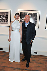 GEMMA ARTERTON and photographer SEBASTIAO SALGADO at a private view of AMAZON an exhibition of photographs in aid of 'Sky Rainforest Rescue' held in the East Wing Galleries, Somerset House, London on 1st November 2011.
