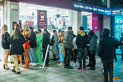 © Licensed to London News Pictures. 10/10/2020. Manchester, UK. People queue outside a branch of Sainsbury's on Deansgate as venues close and people come out on to the street . People out in pubs, bars and restaurants in Manchester City Centre ahead of the currently imposed daily 10pm curfew . Millions of people across the north of England are waiting to learn if the British Government will impose a regional lockdown on Monday (12th October 2020), as Coronovirus infection rates continue to rise rapidly . Photo credit: Joel Goodman/LNP