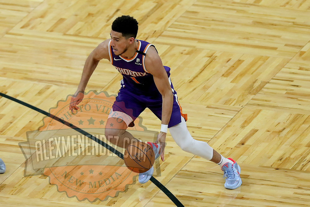 ORLANDO, FL - MARCH 24: Devin Booker #1 of the Phoenix Suns controls the ball against the Orlando Magic at Amway Center on March 24, 2021 in Orlando, Florida. NOTE TO USER: User expressly acknowledges and agrees that, by downloading and or using this photograph, User is consenting to the terms and conditions of the Getty Images License Agreement. (Photo by Alex Menendez/Getty Images)*** Local Caption *** Devin Booker