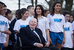 © London News Pictures. 26/02/2014. London, UK. SIR ROGER BANNISTER (centre), the first man to run a sub-four minute mile, at a photocall at Paddington Recreation ground in London to launch the 2014 Bupa Westminster Mile in May 2014, which will officially celebrate the 60th anniversary. The track at Paddington Recreation ground was where Sir Roger Bannister trained for the record attempt. Photo credit: Ben Cawthra/LNP