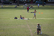 During the UK's Coronavirus pandemic lockdown and in the 24hrs when a further 255 deaths occurred, bringing the official covid deaths to 37,048, <br /> Londoners take their exercise with shadow boxing and riding bikes while social distancing in Ruskin Park, a public green space in the south London borough of Lambeth, on 26th May 2020, in London, England.