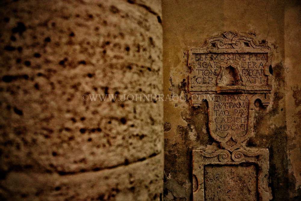 Photo of beautiful, aged stone work and etching in Pienza, Italy.