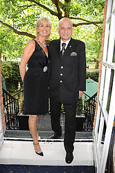 SUZY PARSONS and NAIM ATTALLAH at a party to celebrate the publication on 'Unsuitable' by Suzy Parsons held at St.Stephen's Club, 34 Queen Anne's Gate, London SW1 on 19th June 2008<br /><br />NON EXCLUSIVE - WORLD RIGHTS