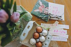 THEMENBILD - selbst beschriftete Ostereier, Servietten und Geschenksanhänger für Ostergeschenke liegen auf einem Tisch, aufgenommen am 10. April 2020, Oesterreich // self labeled Easter eggs, napkins and gift tags for Easter gifts are on a table, Austria on 2020/04/10. EXPA Pictures © 2020, PhotoCredit: EXPA/Stefanie Oberhauser