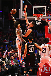 February 14, 2019 - Los Angeles, CA, U.S. - LOS ANGELES, CA - FEBRUARY 13: Phoenix Suns Forward Kelly Oubre Jr. (3) dunks over Los Angeles Clippers Center Ivica Zubac (40) during a NBA game between the Phoenix Suns and the Los Angeles Clippers on February 13, 2019 at STAPLES Center in Los Angeles, CA. (Photo by Brian Rothmuller/Icon Sportswire) (Credit Image: © Brian Rothmuller/Icon SMI via ZUMA Press)