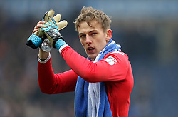 Wigan Athletic goalkeeper Christian Walton applauds the fans after the final whistle