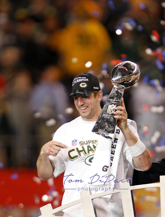 Green Bay Packers Aaron Rodgers SBXLV MVP holds the Vince Lombardi Trophy after the Packers' 31-25 win over the Pittsburgh Steelers in the NFL Super Bowl XLV football game Sunday, Feb. 6, 2011, in Arlington, Texas<br />  (Photo/Tom DiPace)