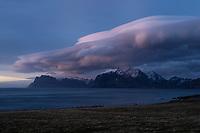 Lenticular clouds float over mountains of Vestvågøy, Lofoten Islands, Norway