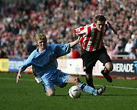 Photo. Andrew Unwin.<br /> Sunderland v Coventry, Coca-Cola Championship, Stadium of Light, Sunderland 19/03/2005.<br /> Sunderland's George McCartney (R) looks to go past Coventry's Claus Jorgensen (L).