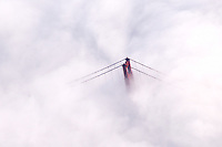 Top Golden Gate Bridge Above the Fog. Image taken while flying out from SFO with a Nikon D3x and 70-300 mm VR lens (ISO 100, 220 mm, f/8, 1/250 sec).