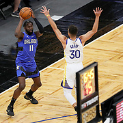 ORLANDO, FL - FEBRUARY 19:  Stephen Curry #30 of the Golden State Warriors plays defense against James Ennis III #11 of the Orlando Magic during the first half at Amway Center on February 19, 2021 in Orlando, Florida. NOTE TO USER: User expressly acknowledges and agrees that, by downloading and or using this photograph, User is consenting to the terms and conditions of the Getty Images License Agreement. (Photo by Alex Menendez/Getty Images)*** Local Caption *** Stephen Curry; James Ennis III