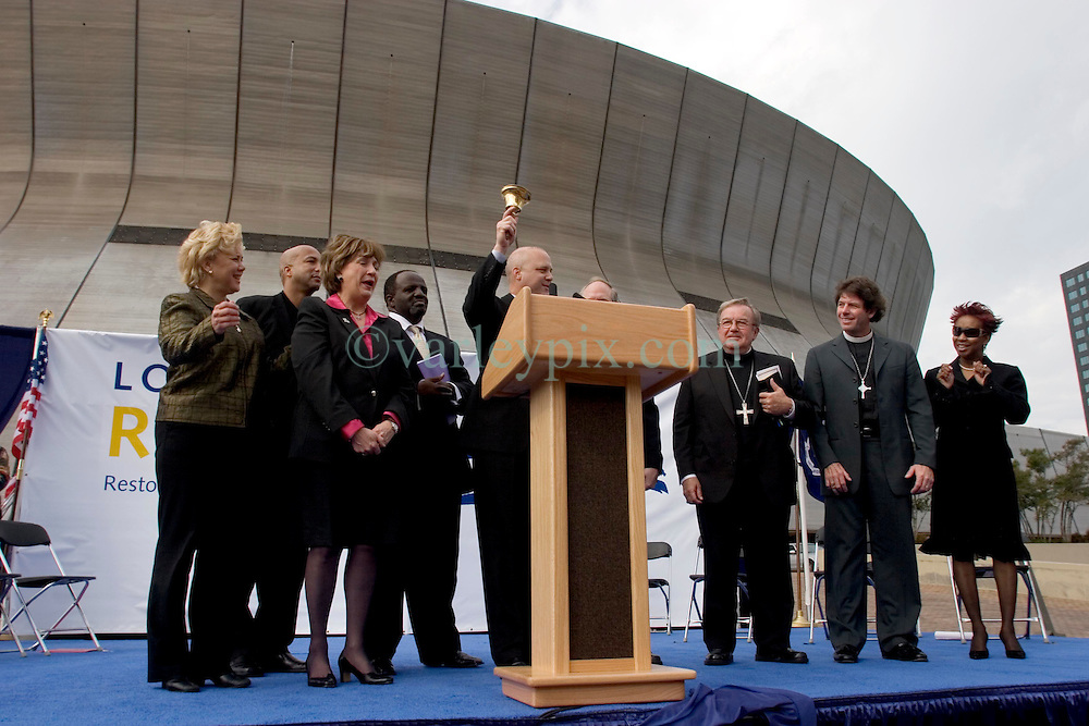 01 January, 2006. New Orleans, Louisiana. Post Katrina aftermath.<br /> New Year's Day in New Orleans, Louisiana. Louisiana Rebirth interfaith service at the Superdome rings out the old disastrous 2005 and rings in what politicians and locals hope will be a successful 2006.  Lieutenant Governor Mitch Landrieu rings in the New Year with (from left) US Senator Mary Landrieu, Mayor Ray Nagin, Governor Kathleen Blanco and religious leaders.<br /> Photo; ©Charlie Varley/varleypix.com