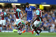 Diego Costa of Chelsea goes past James Collins and  Michail Antonio of West Ham United (r).Premier league match, Chelsea v West Ham United at Stamford Bridge in London on Monday 15th August 2016.<br /> pic by John Patrick Fletcher, Andrew Orchard sports photography.