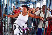 MARCH 19, 2001 - HAVANA, CUBA: A Cuban woman waits to board the ferry across Havana harbor to the Regla neighborhood of Havana, Cuba, March 19, 2001. Regla is across the harbor from the rest of Havana and is the center of the Santeria religion in Cuba. It is also home to many of Havana's oil refineries and heavy industries.    PHOTO BY  JACK KURTZ   TRANSPORTATION  LIFESTYLE  UNEMPLOYMENT  WOMEN