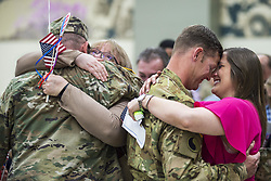 Apr 29, 2017 - Norman, Oklahoma, U.S. - Hugs at Home. Family members welcome Oklahoma Army National Guardsmen at the Armed Forces Reserve Center in Norman, Okla., April 29, 2017, as the soldiers return from a nearly yearlong deployment to the Middle East. Army National Guard photo by 1st Lt. Leanna Litsch. (Credit Image: © Leanna Litsch/Army/DoD via ZUMA Wire/ZUMAPRESS.com)