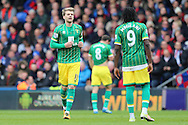 Patrick Bamford of Norwich City (l) talking to Dieumerci Mbokani of Norwich City. Barclays Premier League match, Crystal Palace v Norwich city at Selhurst Park in London on Saturday 9th April 2016. pic by John Patrick Fletcher, Andrew Orchard sports photography.