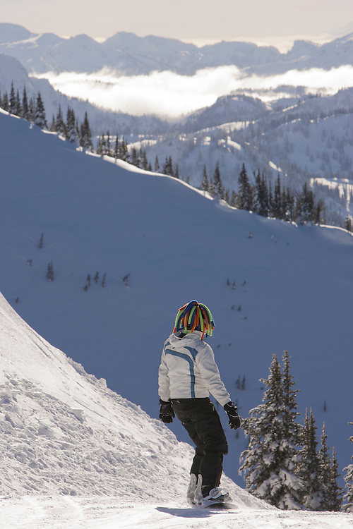 North America, United States, Washington, person with colorful hat on snowboard at Crystal Mountain