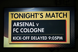 The giant screen shows that kick off is delayed for the Europa League match at the Emirates Stadium, London.