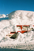 Alaska.  Suburban truck car buried in deep snow fall during winter storm in Valdez.