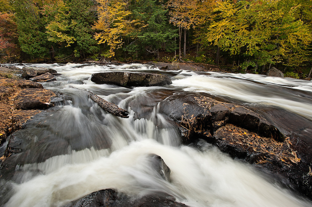 The Raquette River gains power and speed at Buttermilk Falls near Long Lake.