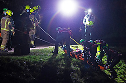 © Licensed to London News Pictures 19/01/2021.        Orpington, UK. The casualty is pulled up the river bank in a rescue stretcher. A person has been rescued from the River Cray in Orpington,South East London tonight by The London Ambulance Hazardous Area Response Team along with firefighters from the London Fire Brigade. Photo credit:Grant Falvey/LNP