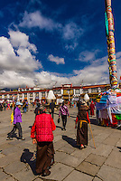 Tibetan pilgrims circumambulating through Barkhor Square and along The Barkhor, Lhasa, Tibet (Xizang), China.