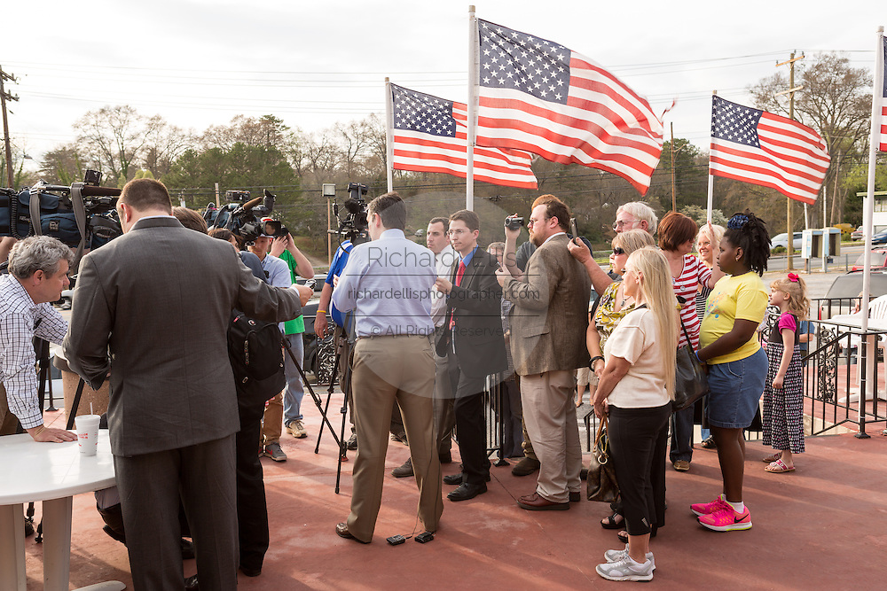 U.S. Senator Ted Cruz and GOP presidential candidate talks to the local media following a town hall meeting at the famous Beacon Drive-in restaurant before April 3, 2015 in Spartanburg, South Carolina.