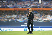 The lonely figure of relegated Bournemouth Manager Eddie Howe gets a few minutes to himself  on the pitch after the Premier League match between Everton and Bournemouth at Goodison Park, Liverpool, England on 26 July 2020.