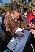 U.S. Senator and GOP presidential candidate Ted Cruz autographs a sign for supporters during a campaign event at Ottawa Farms December 19, 2015 in Bloomingdale, Georgia.