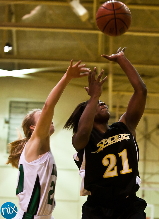 Concord's Jhemelia Edwards goes up for a shot against Kannapolis's Sara Tuttle Saturday night at A.L .Brown High School. Concord won the cross-town rivalry 60-46. (Photo by James Nix)