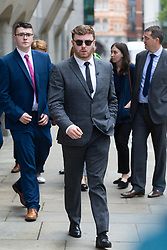 Niall Galbally, centre, the son of Catherine Burke, emerges from the Old Bailey to give a press statement a statement  following the sentencing of Kasim Lewis for the murder of his mother and Luliana Tudos in November 2017. London, July 18 2019.