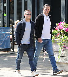 Liverpool footballer Xherdan Shaqiri sits outside a restaurant in Alderley Edge, Cheshire on Monday morning enjoying the sunshine with a friend.