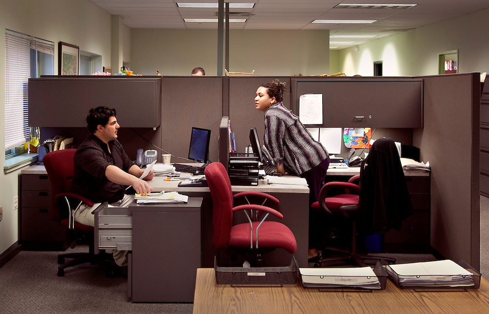 man and woman waste management customer service sales workers in their adjoining offices