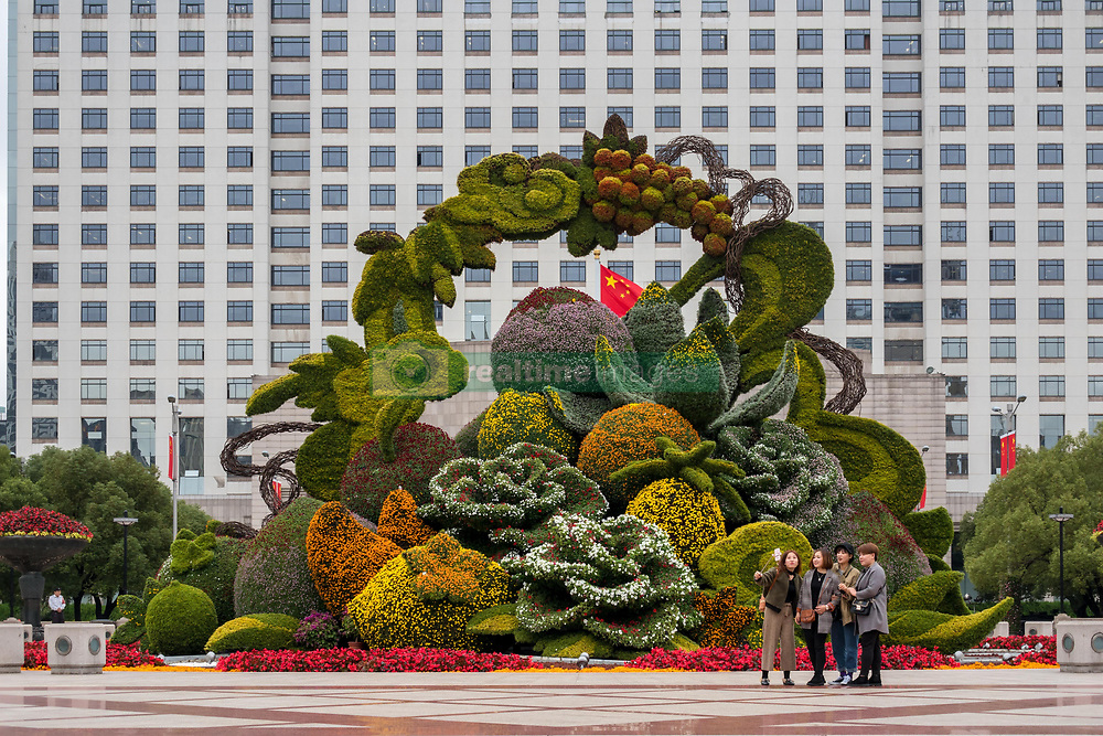 November 10, 2018 - Shanghai, Shanghai, China - Shanghai,CHINA-A giant flower basket shaped parterre can be seen on street in Shanghai, China. (Credit Image: © SIPA Asia via ZUMA Wire)